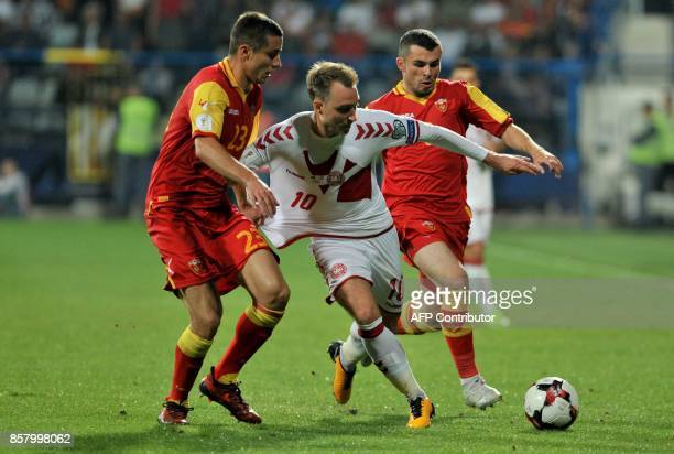 Denmark's Christian Eriksen fights for the ball with Montenegro's Adam Marusic and Vladimir Jovovic during the FIFA WC 2018 Group E football...