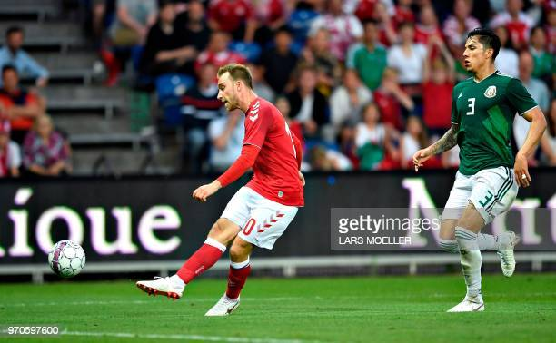 Denmark's Christian Eriksen scores as Carlos Salcedo of Mexico looks on during the international friendly footbal match Denmark vs Mexico in Brondby...