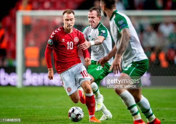 Denmark's Christian Eriksen vies with Ireland's Glenn Whelan during the UEFA Euro 2020 qualifying football match between Denmark and Ireland in Telia...