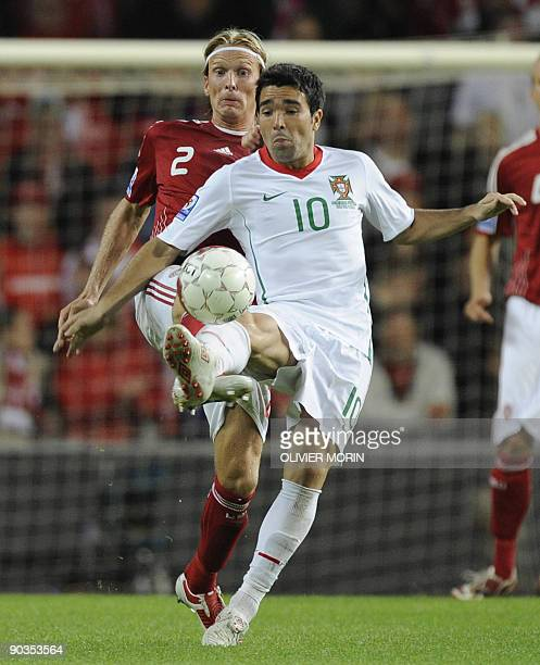 Denmark's Christian Poulsen struggles for the ball with Portugal's Deco during the FIFA World Cup 2010 qualifying match Denmark vs Portugal on...
