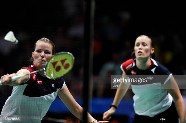 Denmark's Christinna Pedersen and Kamilla Rytter Juhl return to China's Wang Xiaoli and Yu Yang during their women's doubles semifinal at World...