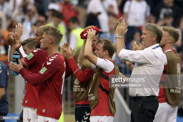 Denmark's coach Age Hareide and players applaud their fans at the end of the Russia 2018 World Cup Group C football match between Denmark and France...