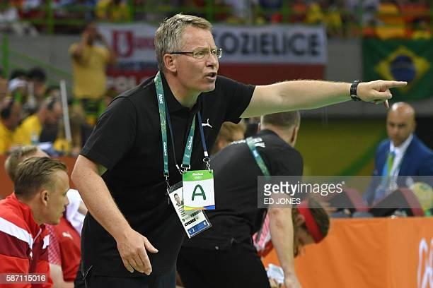 Denmark's coach Gudmundur Gudmundsson gestures during the men's preliminaries Group A handball match Denmark vs Argentina for the Rio 2016 Olympics...