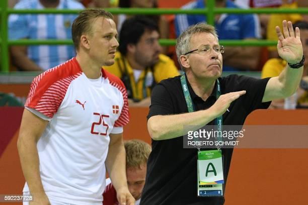 Denmark's coach Gudmundur Gudmundsson gestures past Denmark's centre back Morten Olsen during the men's semifinal handball match Poland vs Denmark...