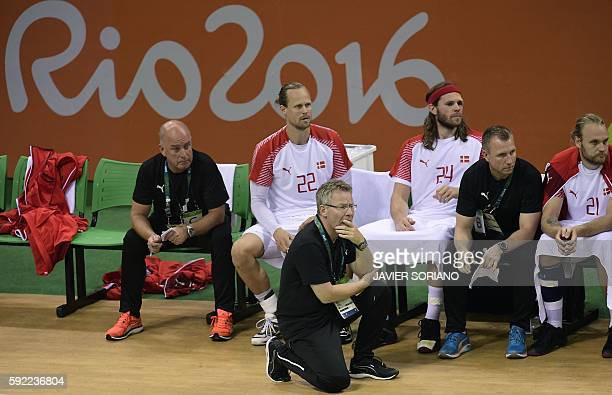 Denmark's coach Gudmundur Gudmundsson looks on during the men's semifinal handball match Poland vs Denmark for the Rio 2016 Olympics Games at the...