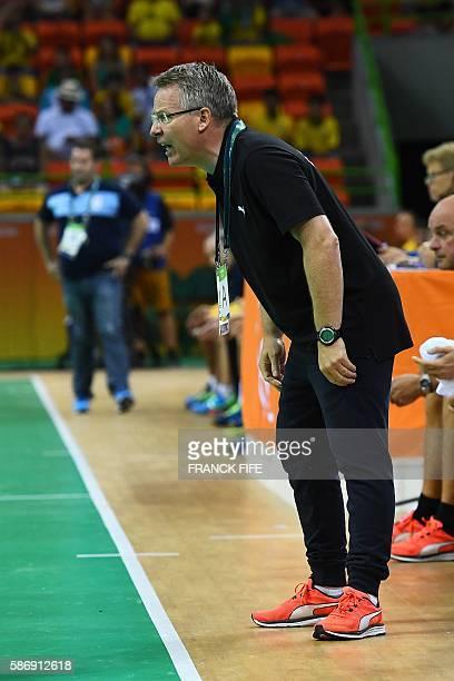 Denmark's coach Gudmundur Gudmundsson shouts during the men's preliminaries Group A handball match Denmark vs Argentina for the Rio 2016 Olympics...