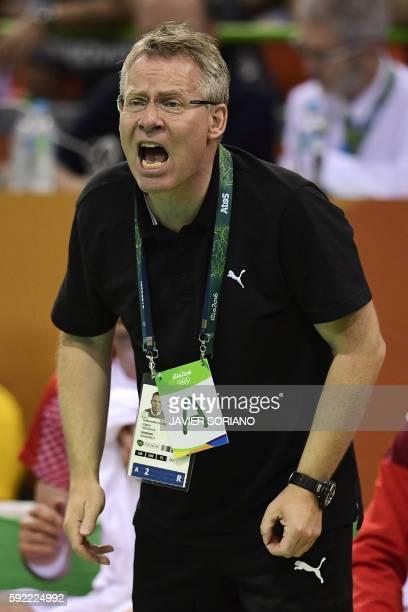 Denmark's coach Gudmundur Gudmundsson shouts during the men's semifinal handball match Poland vs Denmark for the Rio 2016 Olympics Games at the...