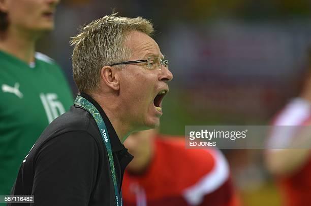 Denmark's coach Gudmundur Gudmundsson shouts instructions during the men's preliminaries Group A handball match Denmark vs Argentina for the Rio 2016...