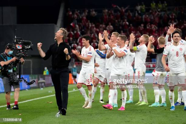 Denmark's coach Kasper Hjulmand celebrates at the end of the UEFA EURO 2020 Group B football match between Russia and Denmark at Parken Stadium in...