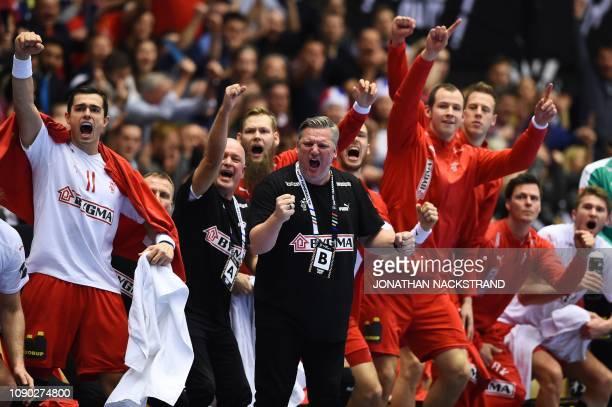 Denmark's coach Nikolaj Jacobsen and his team celebrate during the IHF Men's World Championship 2019 handball final match between Norway and Denmark...