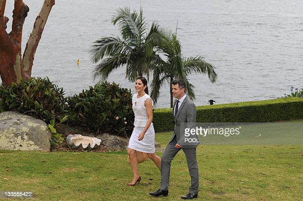 Denmark's Crown Prince Frederik and Australianborn Crown Princess Mary walk through the grounds of Admiralty House in Sydney on November 20 2011 for...
