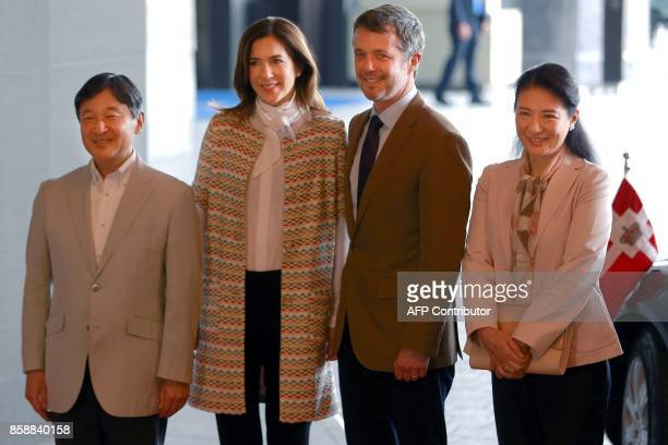 Denmark's Crown Prince Frederik and Crown Princess Mary pose with Japan's Crown Prince Naruhito and Princess Masako at a hotel in Tokyo on October 8...