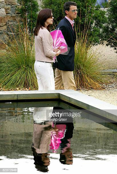 Denmark's Crown Prince Frederik and his Australian-born wife, Crown Princess Mary pass by the Pool of Reflection memorial located behind the Broad...