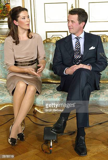 Denmark's Crown Prince Frederik and his fiancee, Mary Elizabeth Donaldson of Australia, attend a media conference at Fredensborg Castle October 8,...