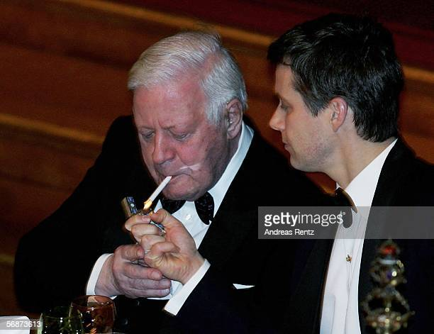 Denmark's Crown Prince Frederik gave former German Chancellor Helmut Schmidt a light for his cigarette at the Mattiae feast on February 17 2006 in...