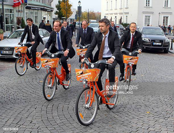 Denmark's Crown Prince Frederik has a tour with a city bike around the old Town Hall and the Rotuse on October 9 2013 in Vilnius during Frederik's...