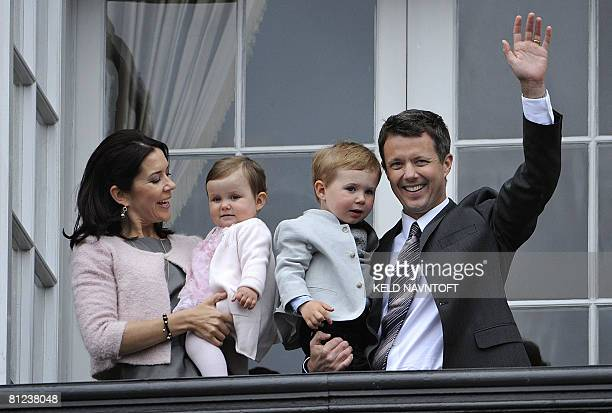 Denmark's Crown Prince Frederik his Australianborn wife Crown Princess Mary and their children Prince Christian and Princess Isabella wave to the...