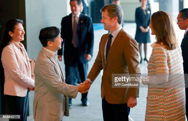 Denmark's Crown Prince Frederik is welcomed by Japan's Crown Prince Naruhito as Crown Princess Mary and Princess Masako watch at a hotel in Tokyo on...