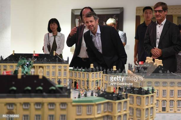 Denmark's Crown Prince Frederik looks at a Lego model of the Frederiksstaden the Danish equivalent of the Forbiddenm City during the opening of an...