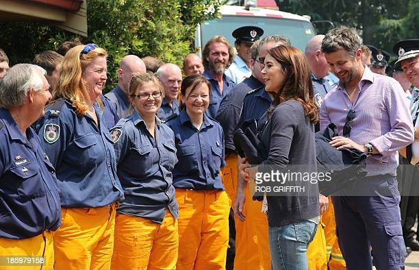 Denmark's Crown Princes Frederick and Princess Mary receive gifts from volunteer firefighters at the Winmalee fire station 85 kms west of Winmalee on...