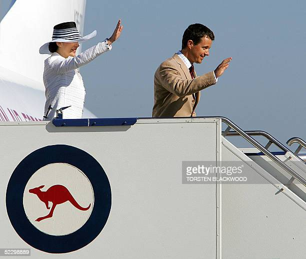 Denmark's Crown Princess Frederik and his Australian-born wife, Crown Princess Mary Donaldson wave to wellwishers upon their arrival in Canberra, 08...