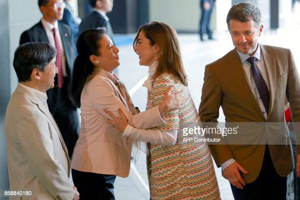Denmark's Crown Princess Mary is welcomed by Japan's Princess Masako beside Crown Prince Frederik and Crown Prince Naruhito at a hotel in Tokyo on...