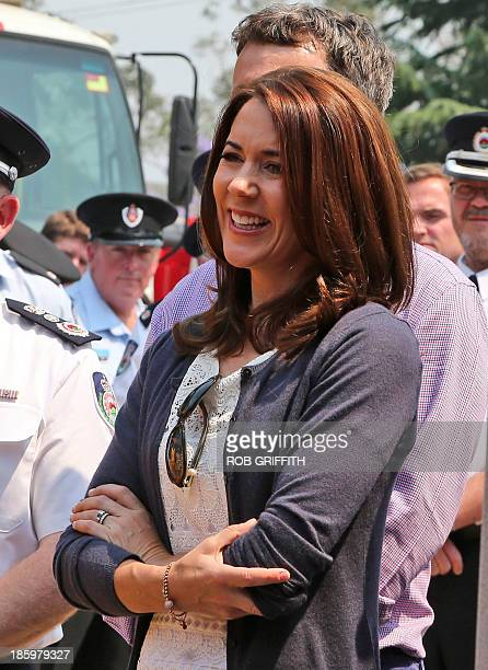 Denmark's Crown Princess Mary laughs as she listens to speeches during a visit to the Winmalee fire station 85 kms west of Sydney on October 27 2013...