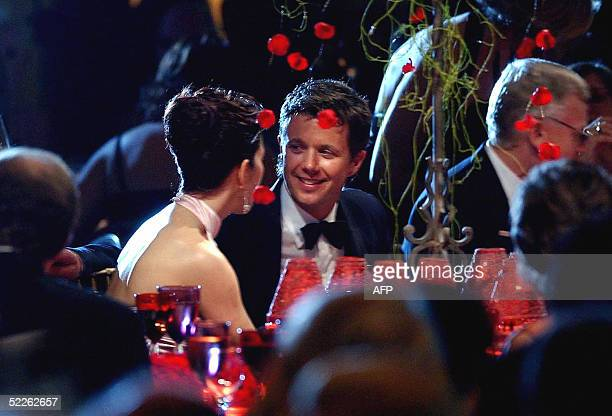 Denmark's Crown Princess Mary speaks with Crown Prince Frederik at a charity dinner for the Australian Red Cross at the Westin Hotel in Sydney 02...