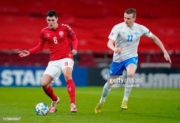 Denmark's defender Andreas Christensen and Iceland's forward Jon Dadi Bodvarsson vie for the ball during the UEFA Nations League between Denmark and...