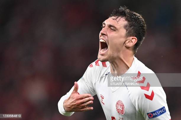 Denmark's defender Andreas Christensen celebrates after scoring his team's third goal during the UEFA EURO 2020 Group B football match between Russia...