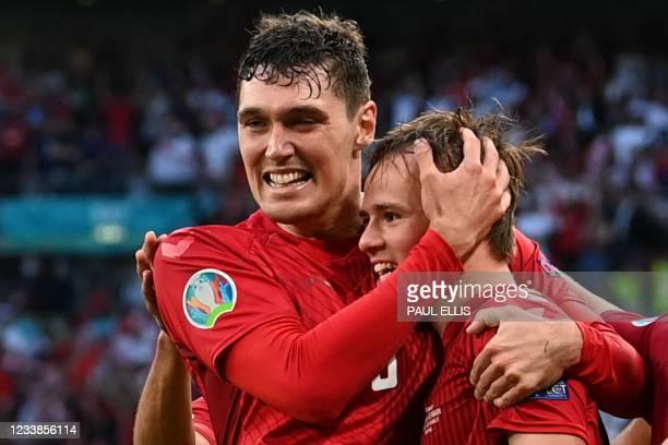 Denmark's defender Andreas Christensen congratulates Denmark's forward Mikkel Damsgaard for his goal during the UEFA EURO 2020 semi-final football...