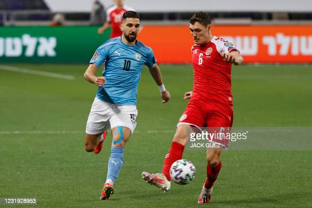 Denmark's defender Andreas Christensen is marked by Israel's forward Munas Dabbur during the 2022 FIFA World Cup qualifier group F football match...