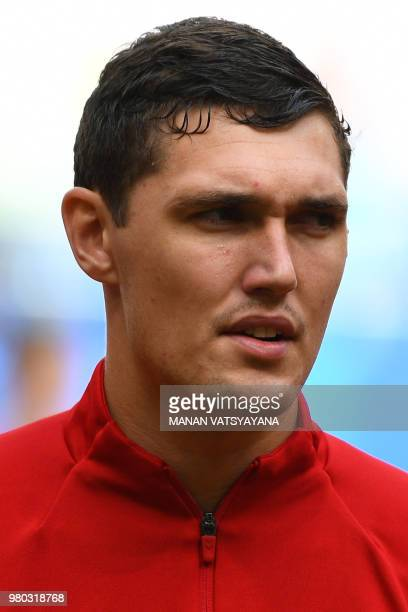 Denmark's defender Andreas Christensen lines up with his teammates for the national anthems before kick off of the Russia 2018 World Cup Group C...