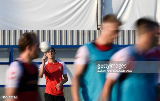 Denmark's defender Andreas Christensen plays with a ball during a training session in Vityazevo on June 27 during the Russia 2018 World Cup football...