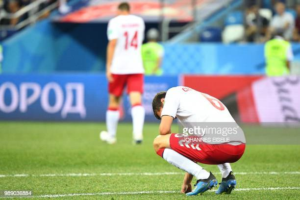 Denmark's defender Andreas Christensen reacts after Croatia's goal during the Russia 2018 World Cup round of 16 football match between Croatia and...