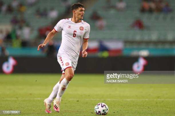Denmark's defender Andreas Christensen runs with the ball during the UEFA EURO 2020 quarter-final football match between the Czech Republic and...