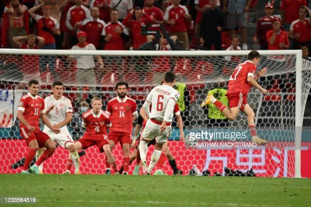 Denmark's defender Andreas Christensen shoots and scores his team's third goalduring the UEFA EURO 2020 Group B football match between Russia and...