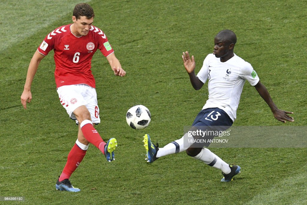 TOPSHOT - Denmark's defender Andreas Christensen (L) vies for the ball with France's midfielder N'Golo Kante during the Russia 2018 World Cup Group C football match between Denmark and France at the Luzhniki Stadium in Moscow on June 26, 2018. (Photo by Mladen ANTONOV / AFP) / RESTRICTED