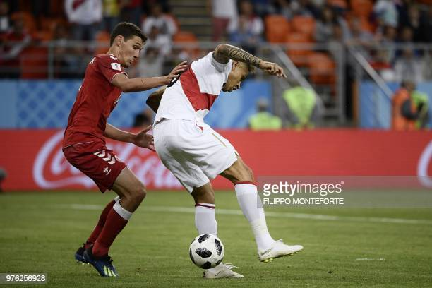 Denmark's defender Andreas Christensen vies for the ball with Peru's forward Paolo Guerrero as he attempts to score during the Russia 2018 World Cup...