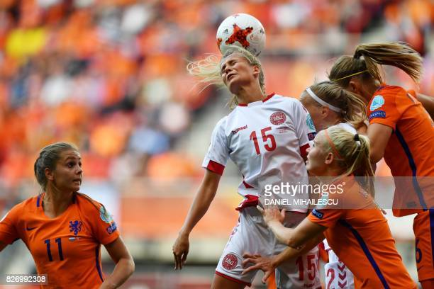 Denmark's defender Frederikke Thogersen heads the ball during the UEFA Womens Euro 2017 football tournament final match between Netherlands and...