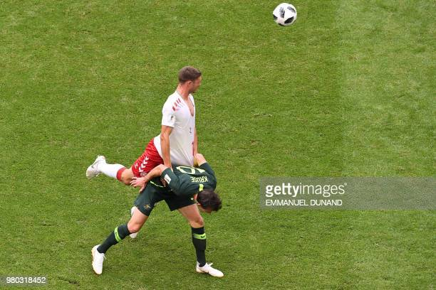 Denmark's defender Henrik Dalsgaard vies for the ball with Australia's forward Robbie Kruse during the Russia 2018 World Cup Group C football match...