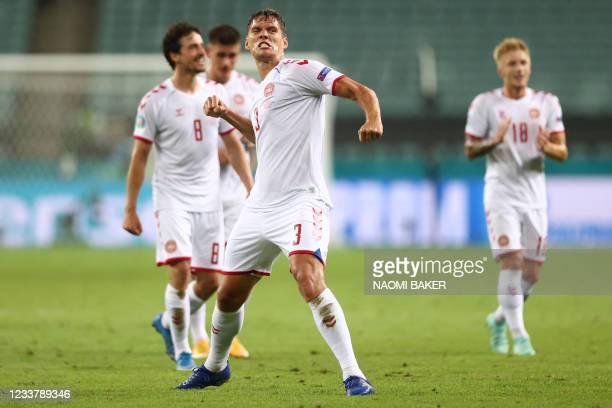 Denmark's defender Jannik Vestergaard celebrates at the end of the UEFA EURO 2020 quarter-final football match between the Czech Republic and Denmark...