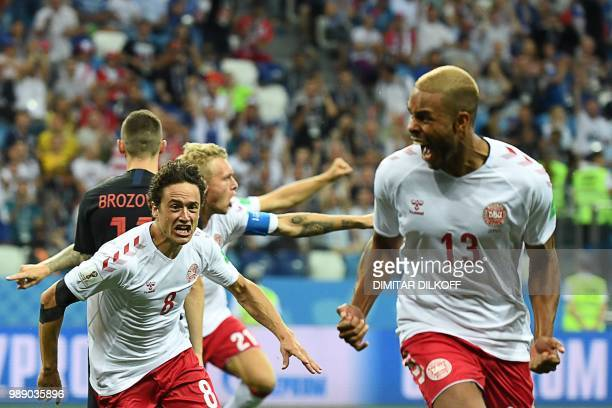 TOPSHOT Denmark's defender Mathias Jorgensen celebrates with midfielder Thomas Delaney after scoring the opening goal during the Russia 2018 World...