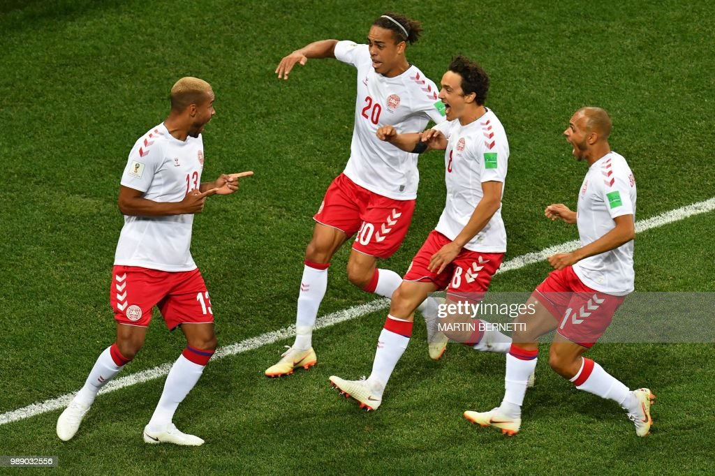 TOPSHOT - Denmark's defender Mathias Jorgensen (L) is congratulated by teammates after scoring the opening goal during the Russia 2018 World Cup round of 16 football match between Croatia and Denmark at the Nizhny Novgorod Stadium in Nizhny Novgorod on July 1, 2018. (Photo by Martin BERNETTI / AFP) / RESTRICTED