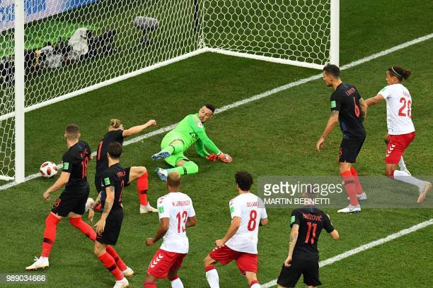 TOPSHOT Denmark's defender Mathias Jorgensen scores a goal during the Russia 2018 World Cup round of 16 football match between Croatia and Denmark at...