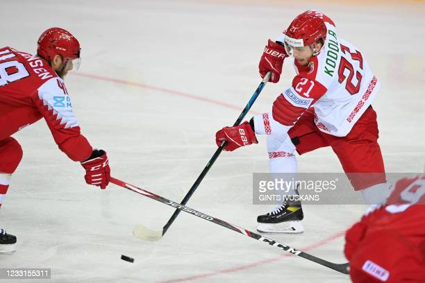 Denmark's defender Nicholas Jensen and Belarus' defender Vladislav Kodola vie during the IIHF Men's Ice Hockey World Championships preliminary round...