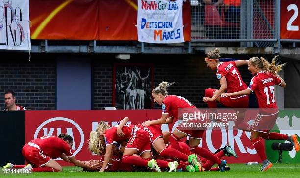Denmark's defender Nielsen Theresa reacts with teammates after scoring during the quarterfinal match of UEFA Women's Euro 2017 football tournament...