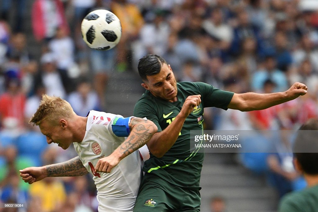 TOPSHOT - Denmark's defender Simon Kjaer (L) and Australia's forward Andrew Nabbout (R) go up for a header during the Russia 2018 World Cup Group C football match between Denmark and Australia at the Samara Arena in Samara on June 21, 2018. (Photo by MANAN VATSYAYANA / AFP) / RESTRICTED