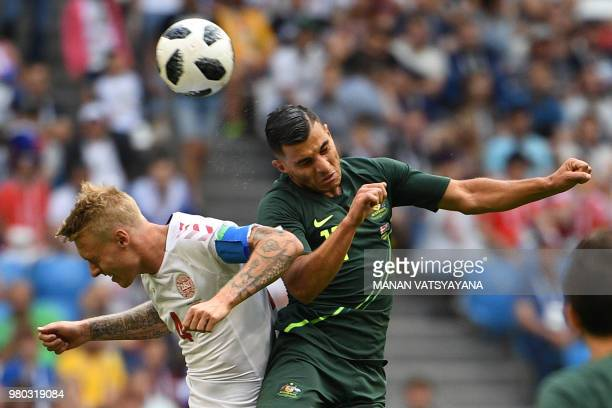 TOPSHOT Denmark's defender Simon Kjaer and Australia's forward Andrew Nabbout go up for a header during the Russia 2018 World Cup Group C football...