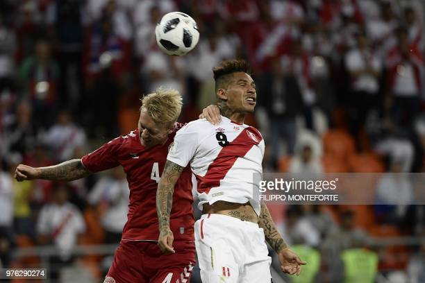 Denmark's defender Simon Kjaer and Peru's forward Paolo Guerrero head the ball during the Russia 2018 World Cup Group C football match between Peru...
